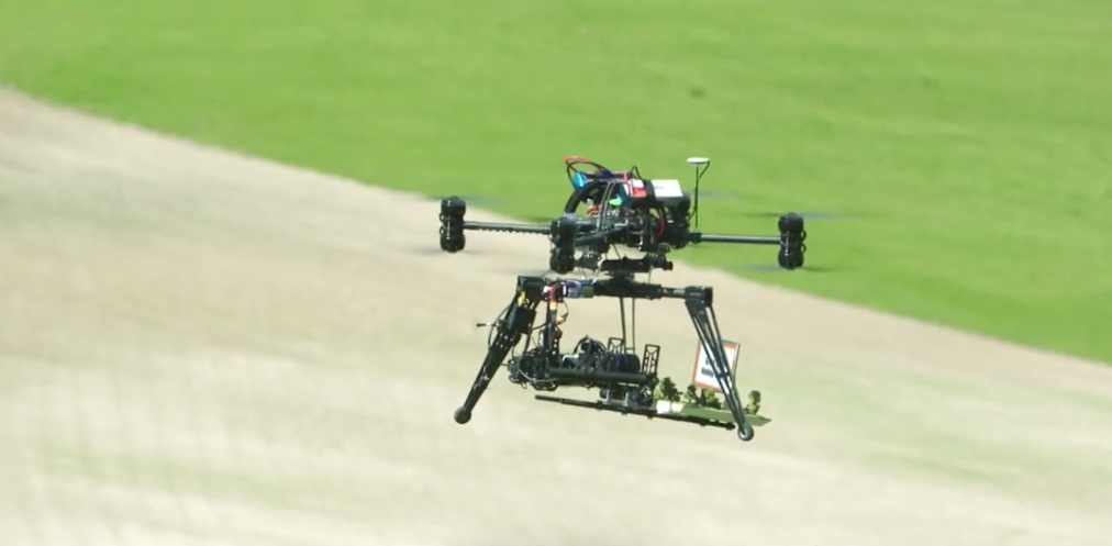Large drone in the air carrying advert board